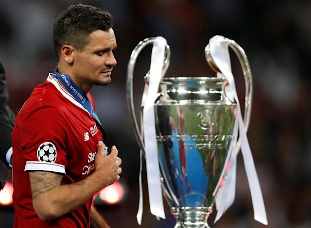 Soccer Football - Champions League Final - Real Madrid v Liverpool - NSC Olympic Stadium, Kiev, Ukraine - May 26, 2018 Liverpool's Dejan Lovren looks dejected as he walks past the Champions League trophy during the medal ceremony after the match REUTERS/Andrew Boyers
