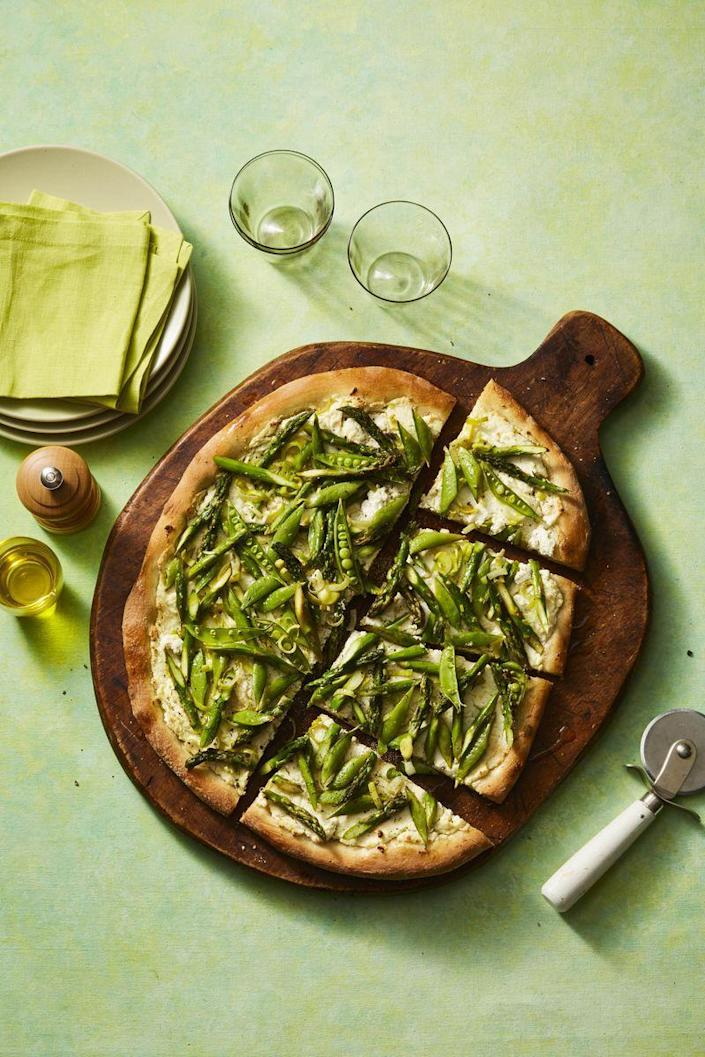 """<p>This delicious pizza is perfect for nights when you just want something lighter.</p><p><a href=""""https://www.womansday.com/food-recipes/food-drinks/a26729638/spring-vegetable-pizza-recipe/"""" rel=""""nofollow noopener"""" target=""""_blank"""" data-ylk=""""slk:Get the Spring Vegetable Pizza recipe."""" class=""""link rapid-noclick-resp""""><em>Get the Spring Vegetable Pizza recipe.</em></a></p>"""