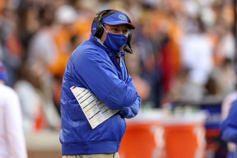 FILE- In this Dec. 5, 2020, file photo, Florida head coach Dan Mullen looks on during the first half of an NCAA college football game against Tennessee in Knoxville, Tenn. The 13th-ranked Gators get a chance to show how much they've improved. Florida opens the season Saturday night against Florida Atlantic. (Randy Sartin/Knoxville News Sentinel via AP, Pool)