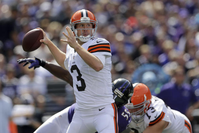 Cleveland Browns quarterback Brandon Weeden looks for an open man during the first half of an NFL football game against the Baltimore Ravens in Baltimore, Md., Sunday Sept. 15, 2013. (AP Photo/Patrick Semansky)