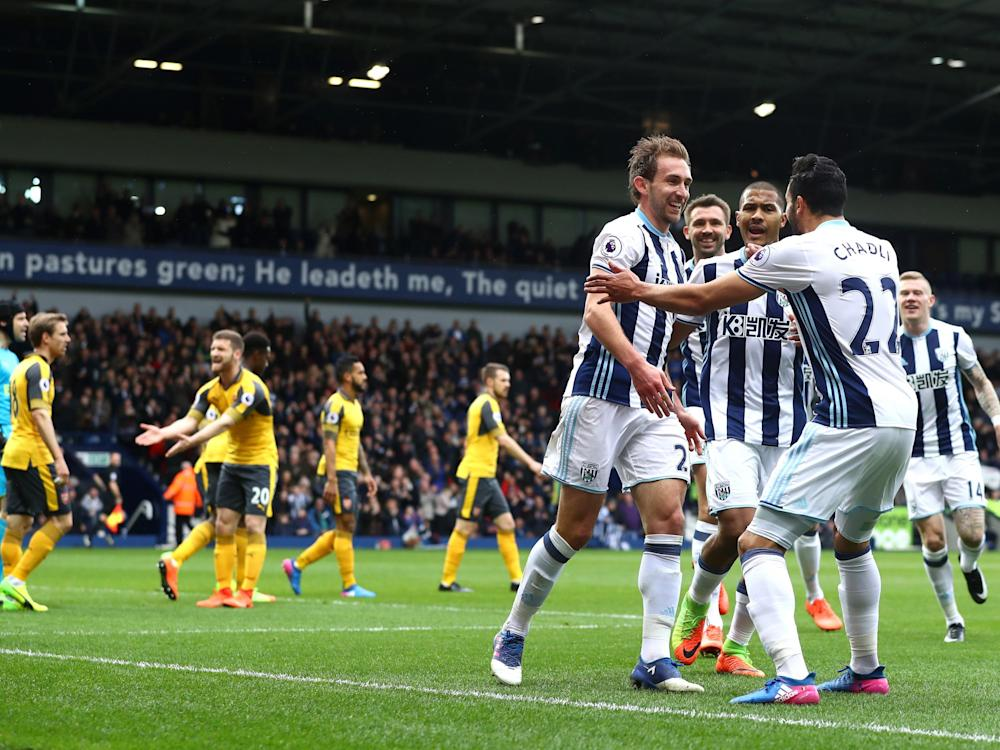 Craig Dawson is mobbed after scoring his second for West Brom: Getty