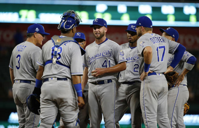 Kansas City Royals starting pitcher Danny Duffy (41) talks with teammates before leaving the mound as the Royals held a seven-run lead during the eighth inning of a baseball game Thursday, May 24, 2018, in Arlington, Texas. (AP Photo/Ron Jenkins)
