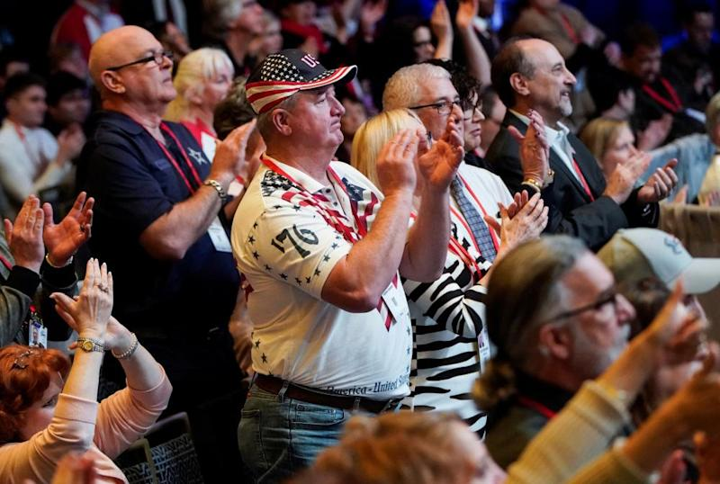 Supporters applaud Mike Pence's speech on Thursday.