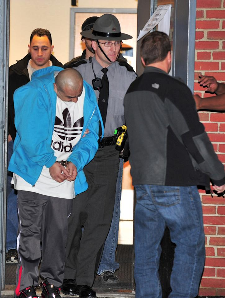 Pennsylvania State Police, along with New York City police officers, transport Julio Acevedo, 44, from the State Police Barracks in Bethlehem, Pa, Wednesday night, March 6, 2013, to the Lehigh County Prison. Acevedo was wanted by the New York City Police in connection with leaving the scene of an accident resulting in the death of expectant parents Nachman and Raizy Glauber. Their premature child also died as a result of the accident. (AP Photo/Tim Wynkoop)