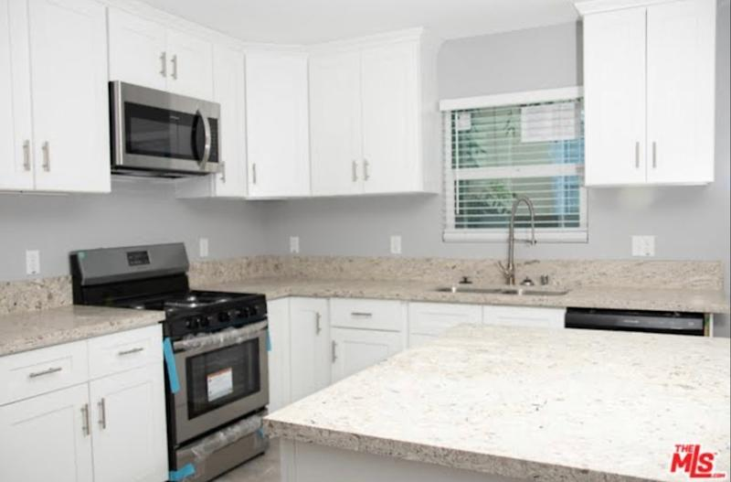 """BEFORE: The kitchen felt cramped and lacked design elements. """"Our main goal was to add character and charm to the home, so it could blend in seamlessly with the other homes in the neighborhood,"""" says Shanty."""