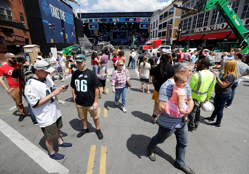 Spectators see the development of the NFL scene built before the first round of the NFL draft in Nashville, Tenn. (AP Photo)