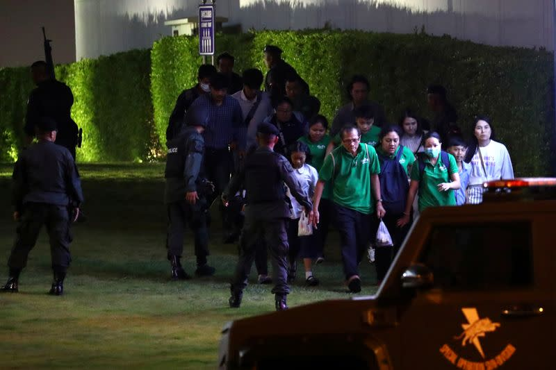 Thailand security forces evacuated people from a shopping mall as they chase a shooter hidden in after a mass shooting in front of the Terminal 21, in Nakhon Ratchasima, Thailand