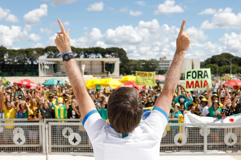 Brazilian President Jair Bolsonaro greets supporters in front of the Planalto Palace, after a protest against the National Congress and the Supreme Court, in Brasilia, on March 15, 2020. (Photo by Sergio LIMA / AFP) (Photo by SERGIO LIMA/AFP via Getty Images)