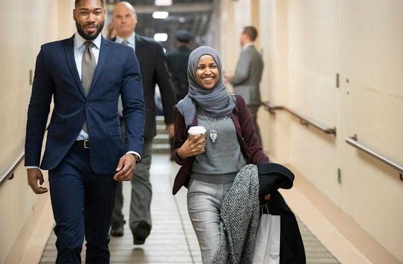 Rep.-elect Ilhan Omar, D-Minn., center, heads to a Democratic Caucus meeting in the basement of the Capitol as new members of the House and veteran representatives gathered behind closed doors to discuss their agenda when they become the majority in the 116th Congress, in Washington, on Nov. 15, 2018. (Photo: ASSOCIATED PRESS/J. Scott Applewhite)