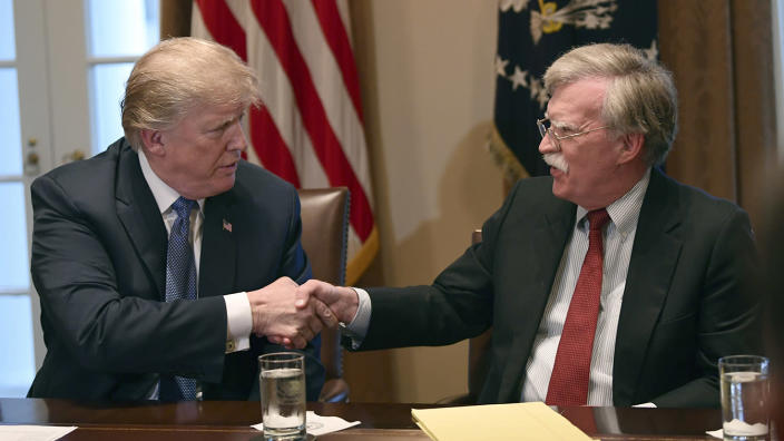 President Trump with then-national security adviser John Bolton in April 2018. (Photo: Susan Walsh/AP)
