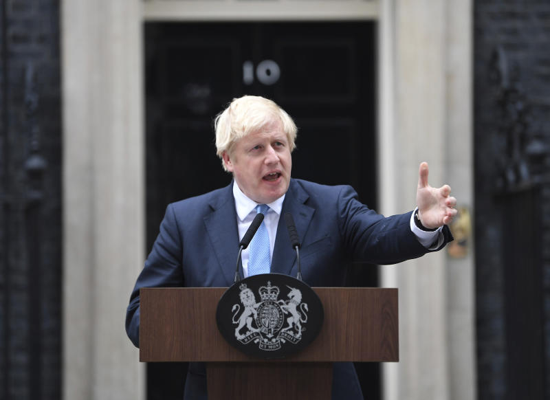 Britain's Prime Minister Boris Johnson speaks to the media outside 10 Downing Street in London, Monday, Sept. 2, 2019. Johnson says chances of a Brexit deal are rising  (Victoria Jones/PA via AP)