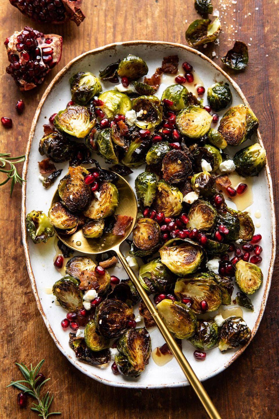 """<p>A sweet and tangy vinaigrette, salty bacon, and creamy goat cheese team up for a side that will send everyone back for seconds. The pomegranate seed topping is <em>almost</em> too pretty to eat. </p><p><strong>Get the recipe from <a href=""""https://www.halfbakedharvest.com/roasted-bacon-brussels-sprouts/"""" rel=""""nofollow noopener"""" target=""""_blank"""" data-ylk=""""slk:Half-Baked Harvest"""" class=""""link rapid-noclick-resp"""">Half-Baked Harvest</a>.</strong></p>"""
