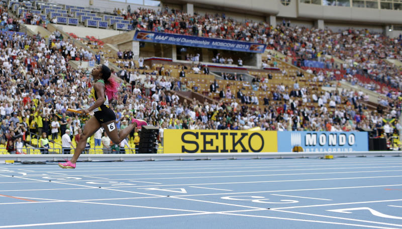 Jamaica's Shelly-Ann Fraser-Pryce crosses the finish line to win the women's 4x100-meter relay at the World Athletics Championships in the Luzhniki stadium in Moscow, Russia, Sunday, Aug. 18, 2013. (AP Photo/David J. Phillip)