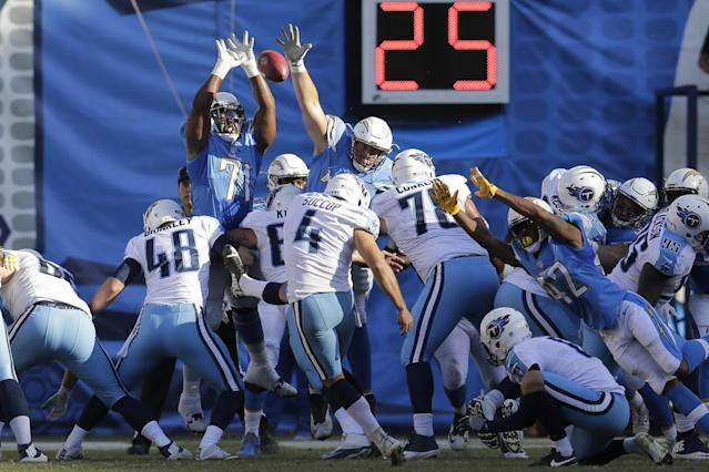 <p>San Diego Chargers nose tackle Damion Square, top left, gets his hands up as Tennessee Titans kicker Ryan Succop kicks an extra point field goal during the first half of an NFL football game Sunday, Nov. 6, 2016, in San Diego. (AP Photo/Rick Scuteri) </p>