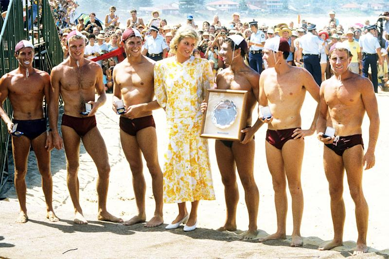 A group of Australian lifeguards in Speedos under Diana's spell during one of her many trips to the continent.