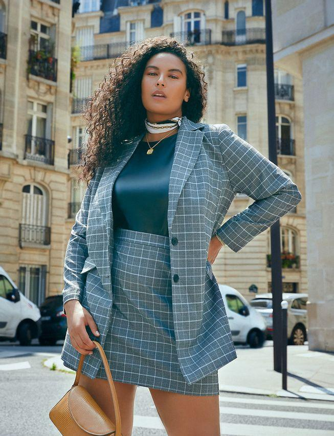 """<h2>Eloquii Plaid Longline Blazer & Miniskirt Suit Set</h2>This plaid suit with the longline blazer and mini skirt set is perfect for the creative professional. The classic glen plaid pattern is easy to mix match and provides many options for wear. It's hard to go wrong with this set. For chillier temperatures, throw on a pair of tights and boots. Also, layer a turtleneck under the blazer to fight those gnarly gusts of wind. <br><br><br><em>Shop<strong><a href=""""https://www.eloquii.com/long-line-plaid-blazer/1268185.html?dwvar_1268185_colorCode=55"""" rel=""""nofollow noopener"""" target=""""_blank"""" data-ylk=""""slk:Eloquii"""" class=""""link rapid-noclick-resp""""> Eloquii</a></strong></em><br><br><strong>Eloquii</strong> Long Line Plaid Blazer, $, available at <a href=""""https://go.skimresources.com/?id=30283X879131&url=https%3A%2F%2Fwww.eloquii.com%2Flong-line-plaid-blazer%2F1268185.html%3Fdwvar_1268185_colorCode%3D55"""" rel=""""nofollow noopener"""" target=""""_blank"""" data-ylk=""""slk:Eloquii"""" class=""""link rapid-noclick-resp"""">Eloquii</a><br><br><strong>Eloquii</strong> Plaid Mini Skirt, $, available at <a href=""""https://go.skimresources.com/?id=30283X879131&url=https%3A%2F%2Fwww.eloquii.com%2Fplaid-mini-skirt%2F1206163.html"""" rel=""""nofollow noopener"""" target=""""_blank"""" data-ylk=""""slk:Eloquii"""" class=""""link rapid-noclick-resp"""">Eloquii</a>"""