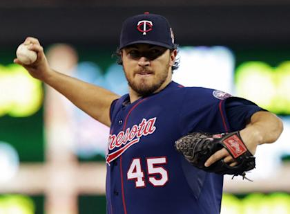 Twins pitcher Phil Hughes has cut down on walks and had real success this season. (AP)