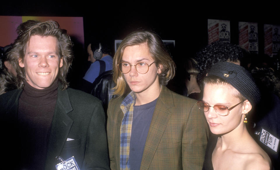 """NEW YORK CITY - FEBRUARY 19: Actor Kevin Bacon, actor River Phoenix and actress Martha Plimpton attend PETA's """"Rock Against Fur"""" Concert on February 19, 1989 at The Palladium in New York City. (Photo by Ron Galella, Ltd./Ron Galella Collection via Getty Images)"""