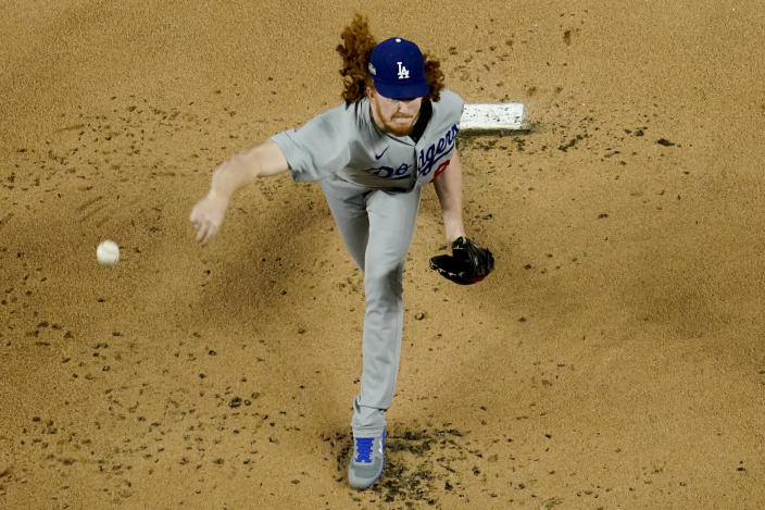 Los Angeles Dodgers starting pitcher Dustin May throws against the Atlanta Braves during the first inning in Game 5 of a baseball National League Championship Series Friday, Oct. 16, 2020, in Arlington, Texas. (AP Photo/David J. Phillip)
