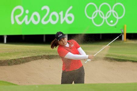 2016 Rio Olympics - Golf - Final - Women's Individual Stroke Play - Olympic Golf Course - Rio de Janeiro, Brazil - 20/08/2016.   Inbee Park (KOR) of Korea hits out of a bunker on the 18th green during final round women's Olympic golf competition.    REUTERS/Kevin Lamarque