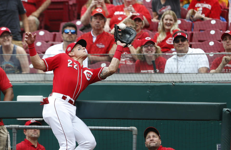 Cincinnati Reds first baseman Derek Dietrich (22) fields a foul ball off the bat of Pittsburgh Pirates' Starling Marte during the first inning of a baseball game, Wednesday, May 29, 2019, in Cincinnati. (AP Photo/Gary Landers)