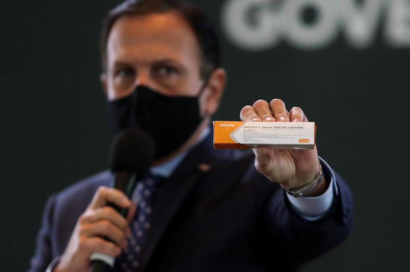 Brazil's Sao Paulo state governor, Joao Doria holds a box of the China's Sinovac coronavirus potential vaccine for trials during a news conference at Hospital das Clinicas, in Sao Paulo, Brazil July 21, 2020. REUTERS/Amanda Perobelli