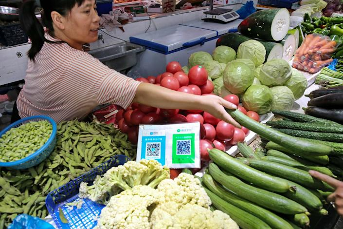 WeChat QR codes are displayed at a grocery store.