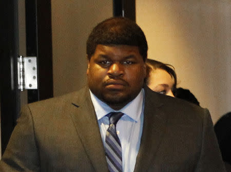 FILE PHOTO: Former Dallas Cowboys player Josh Brent enters the courtroom in Dallas, Texas January 14, 2014. Brent is facing intoxication manslaughter chargers after he crashed his car, killing his friend and teammate Jerry Brown in 2012. REUTERS/Mike Stone