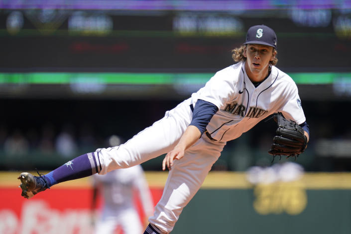 Seattle Mariners starting pitcher Logan Gilbert follows through on a pitch against the New York Yankees in the second inning of a baseball game Thursday, July 8, 2021, in Seattle. (AP Photo/Elaine Thompson)