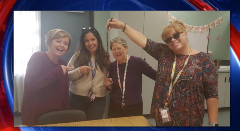 Teachers in hot water after photo shows them smiling with noose