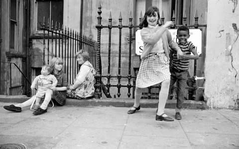 A group of children playing in the street, Powis Square, Notting Hill, London 1964 - Credit: UniversalImagesGroup