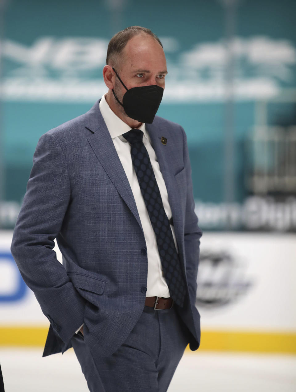 FILE - Vegas Golden Knights coach Peter DeBoer leaves the ice at the end of the first period during an NHL hockey game against the San Jose Sharks in San Jose, Calif., in this Saturday, Feb. 13, 2021, file photo. The four coaches left in the NHL playoffs have connections to each other, but they all took different paths to get to this point. (AP Photo/Josie Lepe, File)