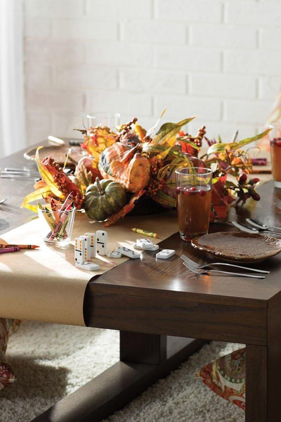 """<p>Add some harvest-time charm to the kids' table with this durable centerpiece, featuring a mix of faux berries, gourds, leaves that can be used year after year.<br></p><p><strong><a class=""""link rapid-noclick-resp"""" href=""""https://go.redirectingat.com?id=74968X1596630&url=https%3A%2F%2Fwww.wayfair.com%2Fkeyword.php%3Fkeyword%3Dfall%2Bcenterpiece%26command%3Ddosearch%26new_keyword_search%3Dtrue&sref=https%3A%2F%2Fwww.countryliving.com%2Fentertaining%2Fg2130%2Fthanksgiving-centerpieces%2F"""" rel=""""nofollow noopener"""" target=""""_blank"""" data-ylk=""""slk:SHOP FALL CENTERPIECES"""">SHOP FALL CENTERPIECES</a></strong></p>"""