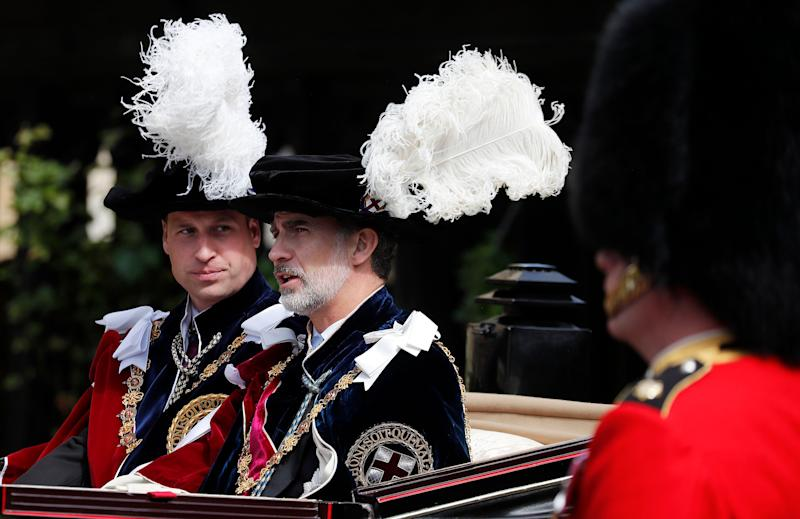 Prince William and Spain's King Felipe sit in a carriage after the Order of the Garter service. (Photo: ASSOCIATED PRESS)