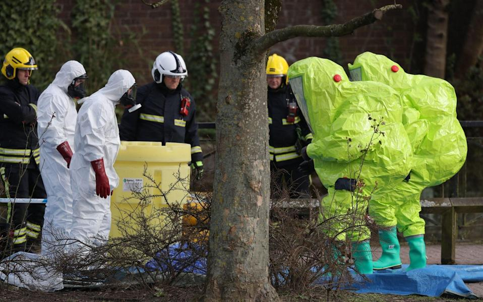 Personnel in hazmat suits waiting for decontamination after securing a tent covering a bench in the Maltings shopping centre in Salisbury, where former Russian double agent Sergei Skripal and his daughter Yulia were found critically ill due to exposure to the nerve agent Novichok. - Andrew Matthews/PA Wire