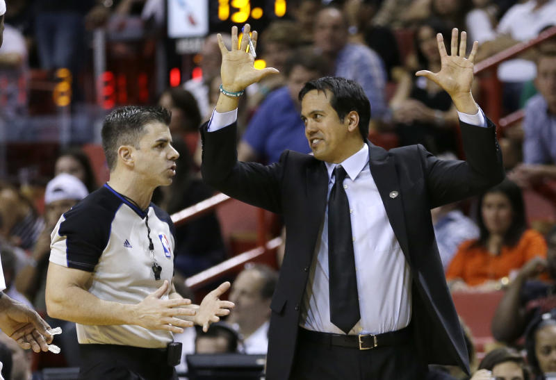 Miami Heat head coach Erik Spoelstra, right, gestures as he argues a call with official Eli Roe during the double overtime of an NBA basketball game in Miami, Friday, April 4, 2014. The Timberwolves won 122-121. (AP Photo/Alan Diaz)