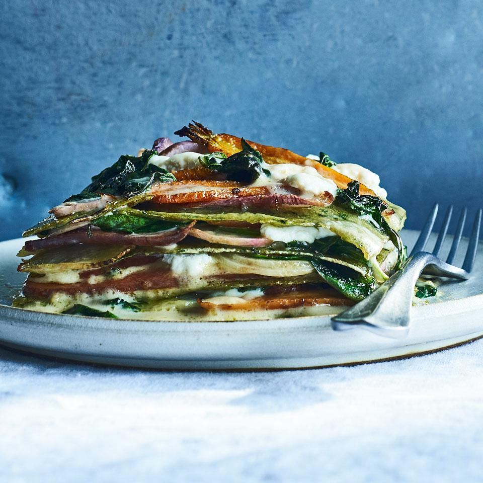 """<p>No-boil noodles help get this crowd-pleasing vegetarian lasagna in the oven fast. Using a mandoline isn't essential, but will make quick work of producing thin, uniform slices of roots that cook super-evenly and look stunning. Serve with a mixed green salad with red-wine vinaigrette and crusty bread. <a href=""""https://www.eatingwell.com/recipe/263914/spring-vegetable-lasagna/"""" rel=""""nofollow noopener"""" target=""""_blank"""" data-ylk=""""slk:View Recipe"""" class=""""link rapid-noclick-resp"""">View Recipe</a></p>"""