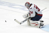 Washington Capitals goaltender Ilya Samsonov makes a save during the first period of the team's NHL hockey game against the New York Islanders, Thursday, April 22, 2021, in Uniondale, N.Y. (AP Photo/Kathy Willens)