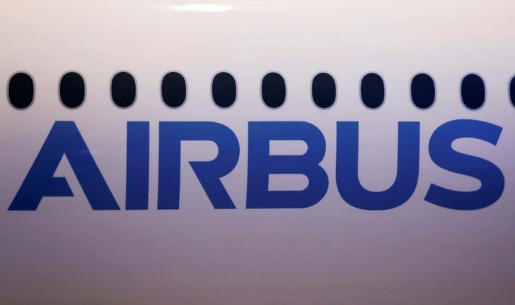 The logo of Airbus is pictured on a scale model of an Airbus A350-1000 during its maiden flight event in Colomiers near Toulouse, Southwestern France
