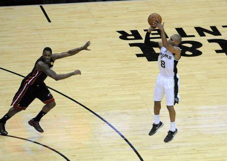Jun 15, 2014; San Antonio, TX, USA; San Antonio Spurs guard Patyy Mills (8) shoots in the second half against the Miami Heat in game five of the 2014 NBA Finals at AT&T Center. Brendan Maloney-USA TODAY Sports