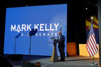 Mark Kelly, Arizona Democratic candidate for U.S. Senate, gestures as he speaks during an election night event Tuesday, Nov. 3, 2020 in Tucson, Ariz. (AP Photo/Ross D. Franklin)