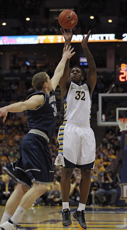 MILWAUKEE, WI - MARCH 03:  Jae Crowder #32 of the Marquette Golden Eagles puts up a shot over Nate Lubick #34 of the Georgetown Hoyas on his way to a game-high 26 points at the Bradley Center on March 3, 2012 in Milwaukee, Wisconsin. Marquette defeated Georgetown 83-69.  (Photo by Jonathan Daniel/Getty Images)