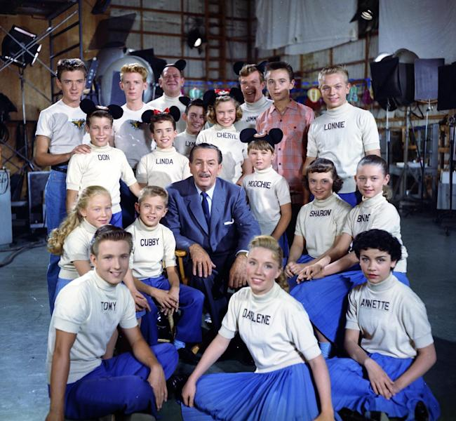 "This 1957 publicity photo released by The Walt Disney Company shows the Mouseketeers, including Annette, front right, with Walt Disney, center. Spin, (Tim Considine), top left, Marty, (David Stollery ), top second left, and Tommy Kirk, top second right, appeared on the ""Mickey Mouse Club"" television show in serials ""Spin and Marty"" and ""The Hardy Boys."" The stage at Walt Disney Studios where ""The Mickey Mouse Club"" was filmed is now officially the Annette Funicello Stage. Disney chief Bob Iger led a ceremony Monday, June 24, 2013, dedicating the soundstage to Funicello, the Mouseketeer-turned-movie star who died in April at age 70. (AP Photo/The Walt Disney Company)"
