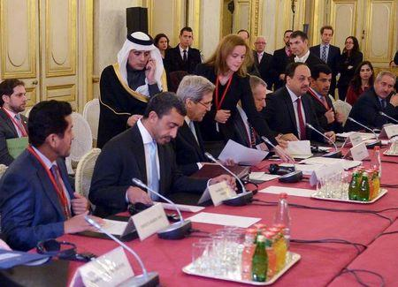 Saudi Arabia's Foreign Minister Al-Jubeir walks up to talk with U.S. Secretary of State Kerry at the start of a ministerial meeting on Syria at the Quai d'Orsay, Ministry of Foreign Affairs, in Paris