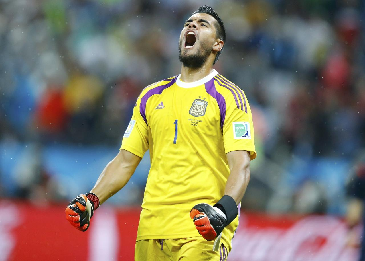 Argentina's goalkeeper Sergio Romero reacts after saving a goal attempt from Ron Vlaar of the Netherlands during a penalty shoot-out during their 2014 World Cup semi-finals at the Corinthians arena in Sao Paulo July 9, 2014. REUTERS/Dominic Ebenbichler (BRAZIL - Tags: SOCCER SPORT WORLD CUP)
