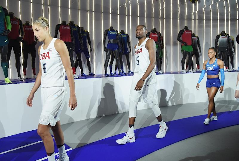Professional basketball players Elena Delle Donne, Kevin Durant, and Sanya Richards-Ross show off the 2016 Olympics uniforms For USA And International Federations Debut in New York City