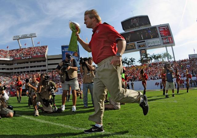 TAMPA, FL - DECEMBER 9: Former coach Jon Gruden of the Tampa Bay Buccaneers carries the Lombardi trophy to the field during half-time ceremonies as the Philadelphia Eagles play December 9, 2012 at Raymond James Stadium in Tampa, Florida. The Bucs celebrated a Super Bowl win 10 years ago. The Eagles won 23 - 21. (Photo by Al Messerschmidt/Getty Images)