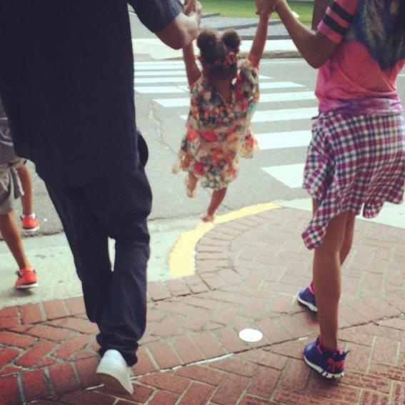 <p>Blue jumps high with a little help from her parents.</p>