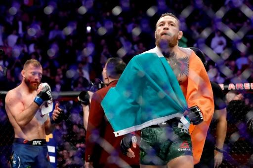 Ireland's Conor McGregor celebrates his first round TKO victory against American Donald Cerrone in a welterweight bout during UFC246 in Las Vegas