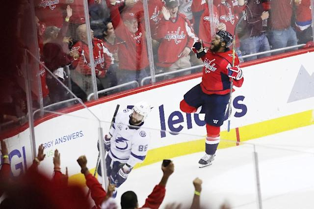 Devante Smith-Pelly of the Washington Capitals celebrates his goal as the Capitals blanked the Tampa Bay Lightning 3-0 to tie their Eastern Conference Final series 3-3 (AFP Photo/Rob Carr)